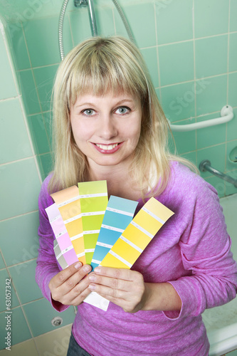 Woman picks colour for painting