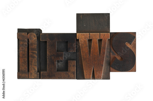 news, word written in vintage printing blocks