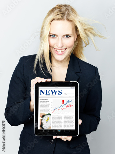 Woman shows news on tablet pc