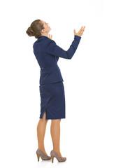 Full length portrait of business woman begging