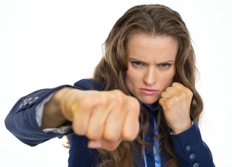 Serious business woman punching in camera