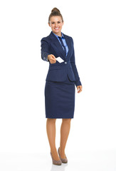 Full length portrait of business woman giving business card