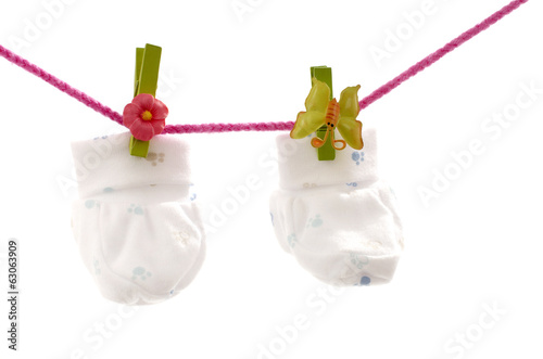Close up on white baby boots hanging isolated