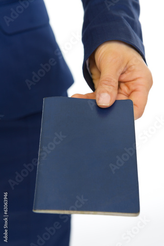 Closeup on business woman giving passport