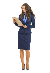 Full length portrait of business woman with clipboard