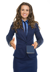 Business woman giving passport and stretching hand for handshake