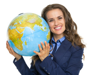 Portrait of happy business woman with earth globe