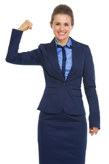 Portrait of happy business woman showing biceps
