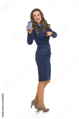 Full length portrait of happy business woman cell phone and poin