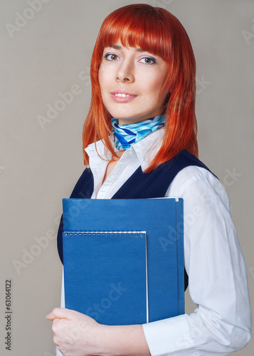 Student with a folder in white and blue uniforms