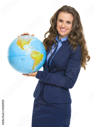 Happy business woman with earth globe