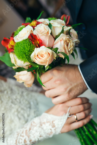 Wedding bouquet with roses in a hands