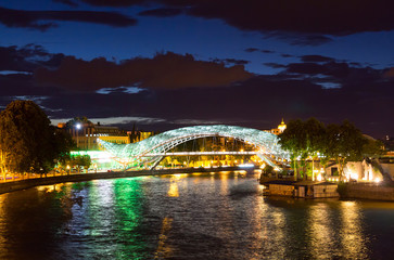 Night view of the brightly lit bridges of Peace