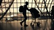 silhouettes of travellers in airport