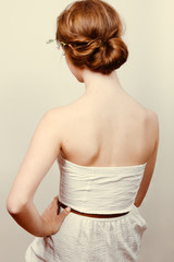 Redhead bride with romantic bun