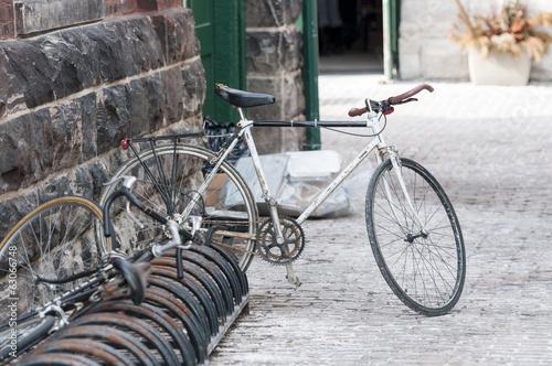 Parked bicycle: at Distillery district Toronto