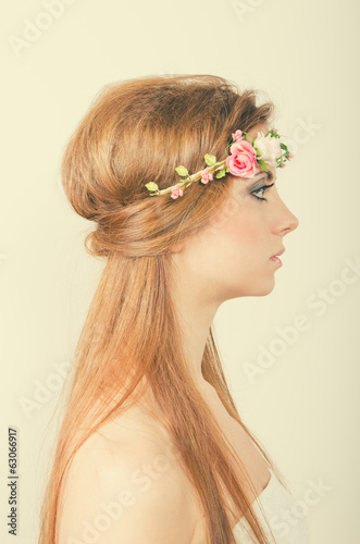 Beautiful blonde with tiara of roses