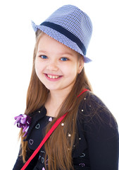 Young girl in a hat.