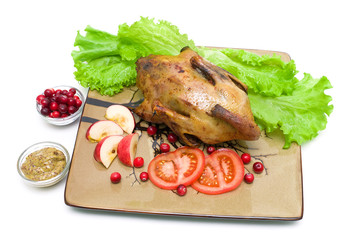 roasted wild duck on a plate - white background.