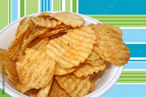 Bowl of spicy barbecued rippled potato chips