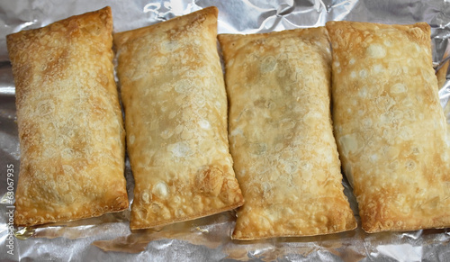Cooked vegetarian egg rolls on aluminum foil