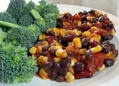 Nutritious vegetarian chili with a side of fresh broccoli