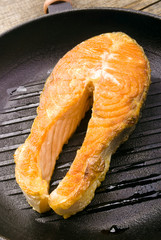 salmon steaks in the iron pan