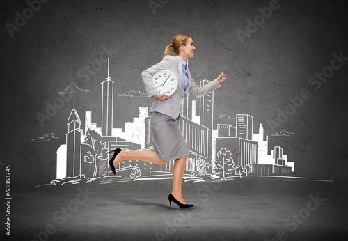 smiling young businesswoman with clock running
