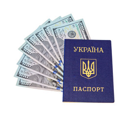Ukrainian passport and  dollar bills over white background