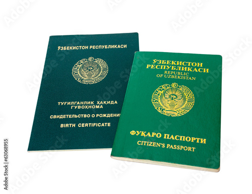 Uzbekistan passport and birth certificate isolated on the white