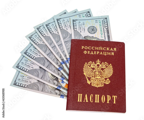 Russian passport and  dollar bills over white background