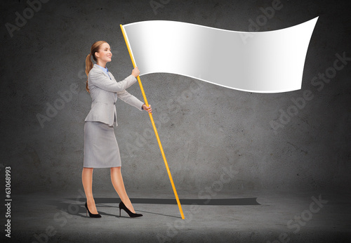 smiling woman holding flagpole with white flag