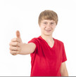 cute boy giving a thumbs up sign