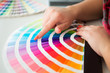 Graphic designer working with pantone palette - 63069992