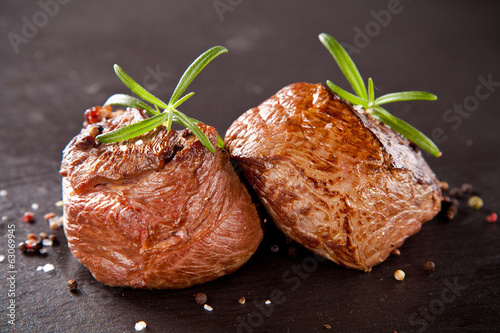 Fresh beef steaks on black stone