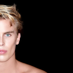 Handsome blond man on Black Background
