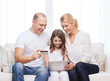 parents and girl with tablet pc and credit card