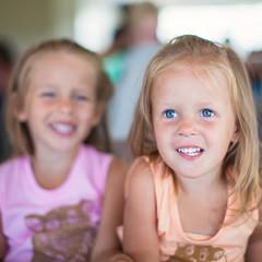 Portrait of two little beautiful blue-eyed girls