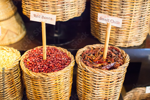 Seeds, beans, pepper and other spices in large baskets