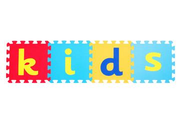 """Word """"kids"""" written on the rubber mats"""