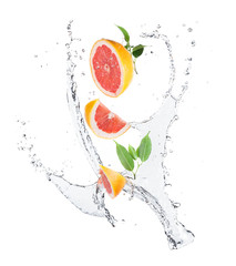 Pieces of grapefruit in water splash