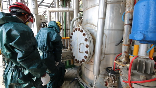 Man in chemical suit to working in chemical plant