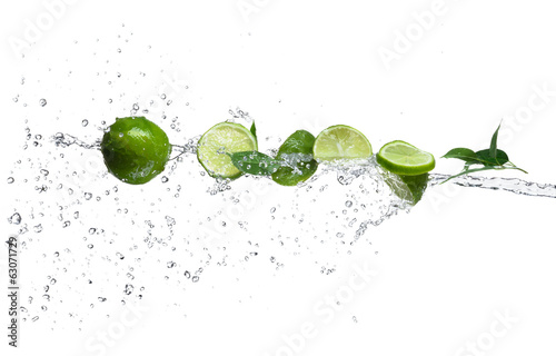 Pieces of limes in water splash