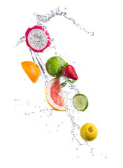 Pieces of exotic fruit in water splash