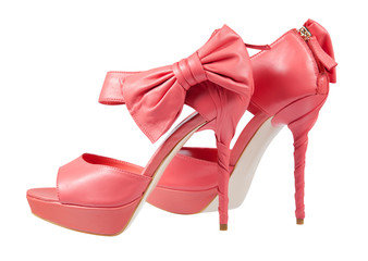 Pink shoes with a bow on a high heel