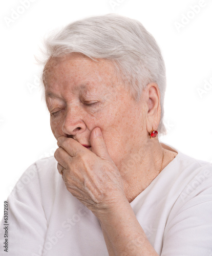 Old sick woman on a white background
