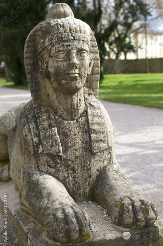 Stone sphinx in the garden