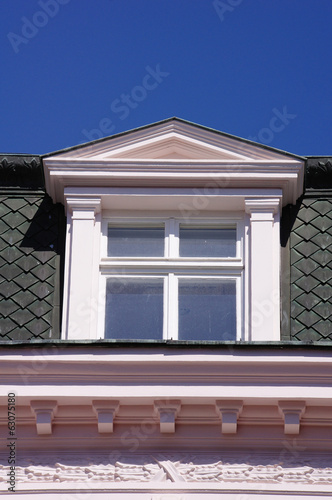 Close up view of old dormer window on the roof