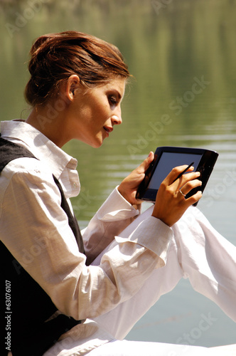 a woman with laptop in park ui