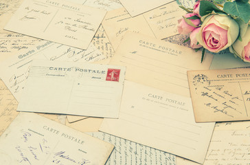 vintage postcards and soft rose flowers. nostalgia
